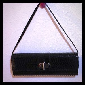 Black clutch with strap